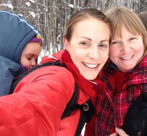 My Mom and I snowshoeing this winter, with my mini-me on my back.